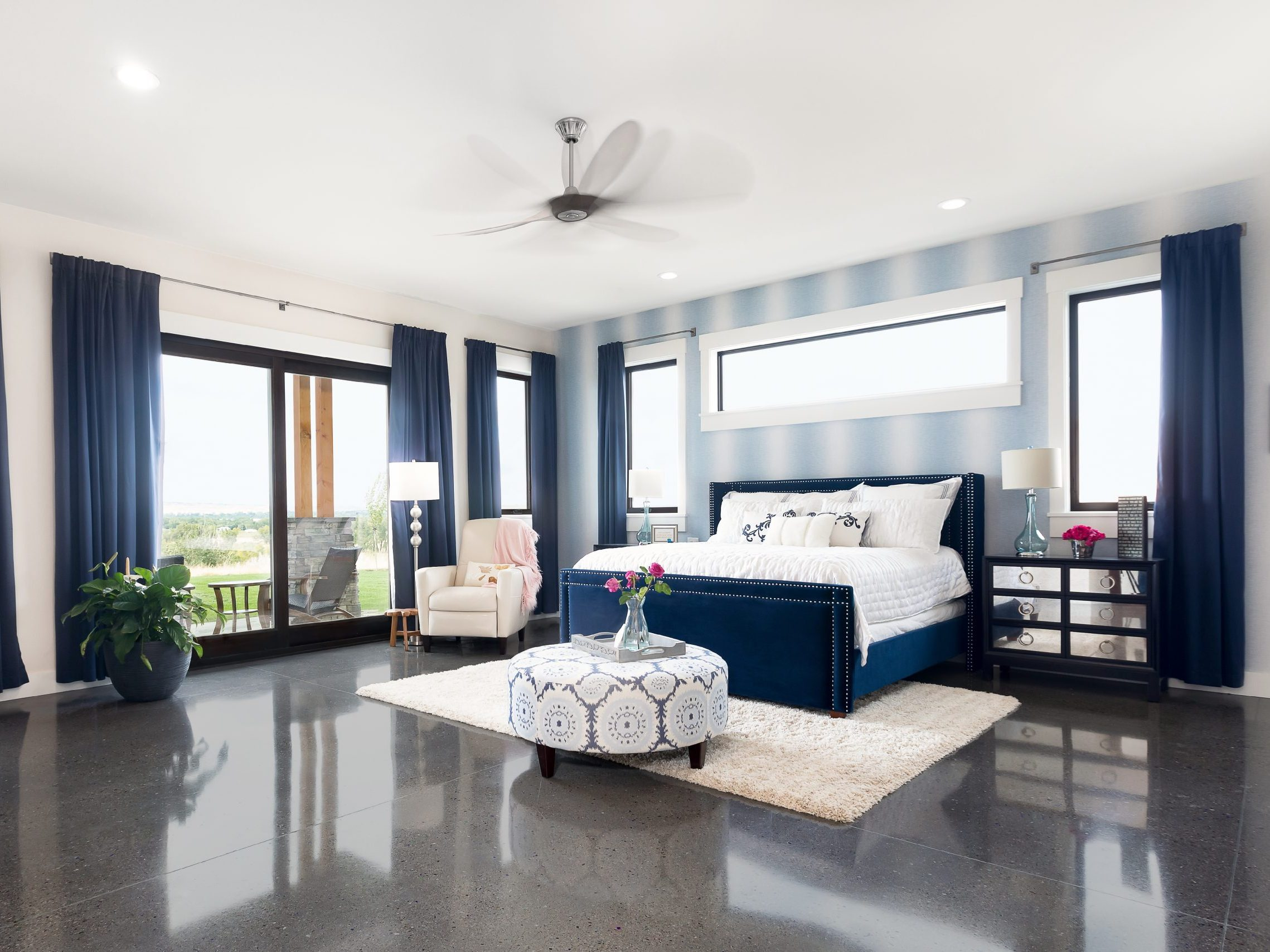 Beautiful Large Windows in Bedroom with Blue Curtains